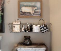 Basement bathroom - like the wire basket idea.