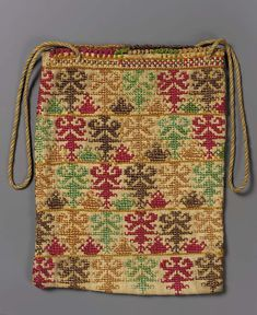 Coarse tabby-woven linen, folded and stitched to form narrow, deep bag. Yellow, cream and beige cord as handle. Faces of bag show conventional plants … Embroidery Bags, Folk Embroidery, Embroidery Fashion, Embroidery Patterns, Fashion Design Template, Ethnic Bag, Palestinian Embroidery, Unique Handbags, Ethnic Patterns