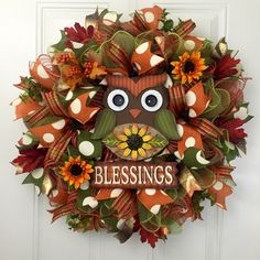 A personal favorite from my Etsy shop https://www.etsy.com/listing/476862067/fall-deco-mesh-wreath-owl-wreath-owl
