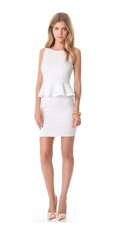 TRACEY PEPLUM DRESS $100.48 SPECIAL $42.46 YOU SAVE: 58% Exclusive to DressyCart.  In soft ponte jersey, this signature alice + olivia peplum dress cuts a polished profile with a fitted bodice and pencil skirt. The ruffled peplum emphasizes a slim waist, and an exposed zip closes the scoop back. Mesh lining.