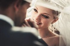 <3 a sweet look the bride and groom while she looks at him and he kisses her hands under the veil