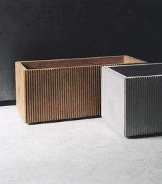 Raita is planter in concrete and is available in color combinations concrete gray and rust colored. With or without drain holes.  length 600 mm width 300 mm height 300 mm weight 12 kg  Design Stina Lindholm.