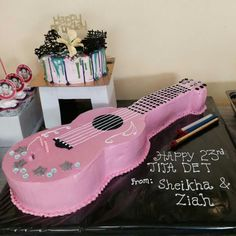 guitar theme cake. I used boiled icing to cover the cake