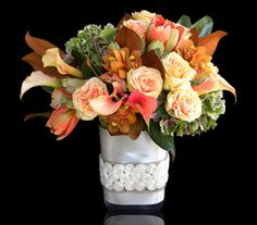 Boston's Autumn Splendour - Hydrangea, roses, calla lilies, amaryllis, and cymbidium orchid blossoms designed in a chic envelope vase, bound with ivory satin ribbon embellished with a rosette ribbon overlay.