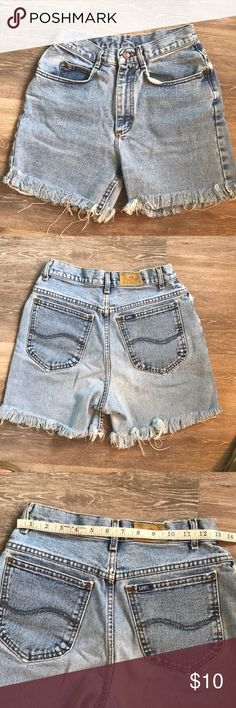 Vintage Lee distressed cutoff denim shorts!  26 These Lee denim shorts are very rugged and in style.  The size tag has been cut out so see pictures for measurements.  The rise is high so make sure you account for that in your own measurements.  Vintage worn look for sure! Lee Shorts Jean Shorts