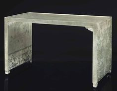 ARMAND ALBERT RATEAU (1882-1938) A DESK, CIRCA 1930 silver leaf decorated wood, with painted details 28½ in. (72.4 cm.) high, 47¼ in. (120 cm.) wide, 23¾ in. (60.3 cm.) deep