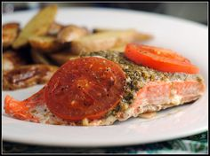 Pesto baked salmon- I left off tomatoes and used Parmesan cheese instead, so good! Served with roasted baby reds, baked both at 450-...20ish minutes.