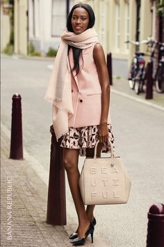 When you start with a color like this, you just want more. Layer a double-breasted soft blush vest over a sleeveless printed dress in more pink. Ground the look with sleek black pumps and a conversation bag that says it all. Beautiful.