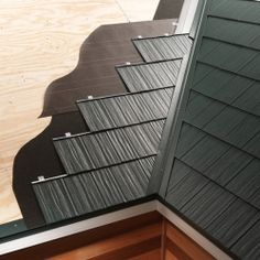 Interlocking metal roofing panels are expensive, but they're DIY—friendly, they look great, and they'll last 50 years or more.