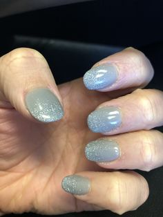 Holiday Nails , Classy yet festive! Gray dipping powder with ombre silver sparkles.