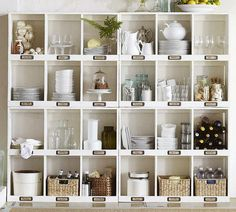 Kitchen Organization - each cubbie is labeled .. baskets an glass jars