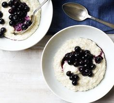 Top high-fibre porridge oats with creamy Greek yogurt and healthy blueberries - buy frozen to help cut the cost of this filling breakfast