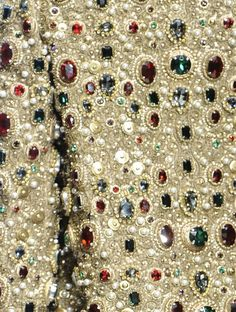 A close-up of a Dolce & Gabbana (Fall 2011) dress encrusted with jewels and paillettes.