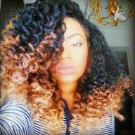 Bantu knot out or twist out. Whatever, the color and style are just fab! To learn how to grow your hair longer click here - http://blackhair.cc/1jSY2ux
