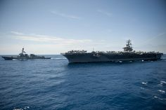 USS Dwight D. Eisenhower and USS Farragut operate in the Atlantic Ocean. by Official U.S. Navy Imagery, via Flickr