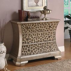 Love the form of the dresser! Would change the animal print to something more classy.