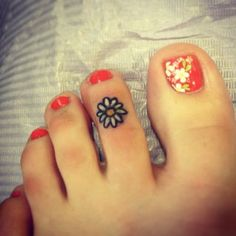 Pretty daisy tattoo (3) - daisy foot tattoo on TattooChief.com