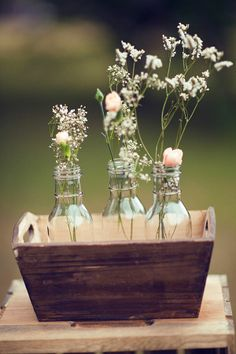 Simple yet beautiful floral centerpiece in clear bottles and in a wooden case #wedding #weddingdecor #centerpiece  #flowers #diywedding