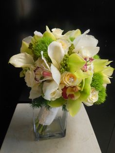 White Roses, White Calla Lilies, White/Pink Cymbidium Orchids, Yellow-Orange Roses, Lime Cymbidium Orchids, Green Trick Dianthus, Green China Berries, Green Foliage Hand Tied Wedding Bouquet