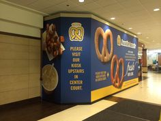 Aunt Annie's Pretzels hides their construction with a clean looking barricade. #barricades #AuntAnniesPretzels #cspdisplay