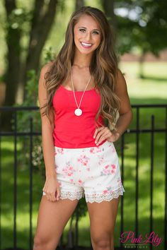 You will have to take a second look when you see these shorts because they will take your breath away! We adore the sweet floral print in red, grey, pink, and white and the lace detail on the bottom hemline is simply lovely! These are going to be your newest summer favorites! Pair it with a solid top, our Monogrammed Hampton Necklace, and our Macy Heels for a sweet look!