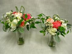 Handtied bouquets of coral and cream garden flowers including peonies, veronica, Juliet garden roses, white asters and clematis vine.