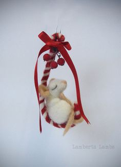 Needle felted mouse on candy cane hanging by LambertsLambs on Etsy
