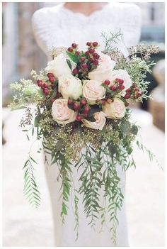 28 Winter Wedding Ideas - winter wedding bouquet with red berries, white roses and greens. #weddingbouquet #winterwedding