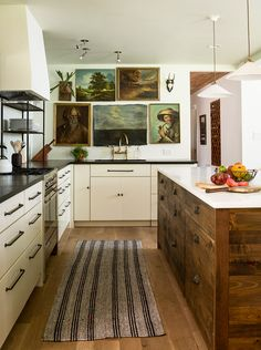 nice kitchen! love the wood, paintings and gold details.