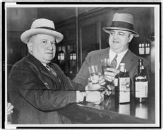 Prohibition's Premier Hooch Hounds (Past Imperfect Blog) - Izzy Einstein (left) and Moe Smith share a toast in New York City (Library of Congress).