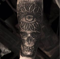 This macabre skull and eye were inked by Mumia. #inked #skulls #tattoo #realism #amazing #skull #mumia