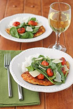 This healthy, light Chicken Milanese with Spinach and Burst Tomatoes is a quick and easy weeknight dinner recipe that comes together in 20 minutes for under 300 calories or 7 Weight Watchers points! www.emilybites.com