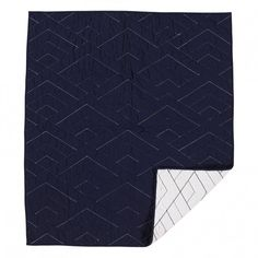 <p>Versatile quilted comforter with modern embroidery detailing. Reversible design allows you to flip over and change up the look of your bedding between white and navy.</p>