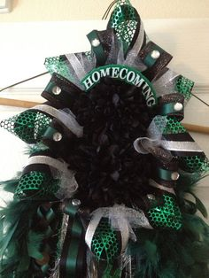 Homecoming Mum -Dark Green and Black - Ready To Ship - Custom Orders Welcome. I'm located in Cypress, TX. I ship orders too. Football Homecoming, Homecoming Mums, Different Braids, Silver Bow, Printed Ribbon, School Colors, All Flowers, Black Ribbon, Bows