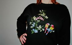 Welcome to Handmaiden. 'Parrots' is from my new range of handmade embroidered sweatshirt. now available in limited numbers to buy at www.handmaidenlondon.com.