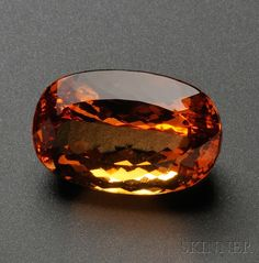 Unmounted Imperial Topaz, the cushion-cut measuring approx. 26.31 x 17.02 x 13.44 mm, weighing 51.64 cts.
