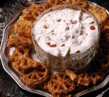 Photo of a some Rosettes around a bowl of Cloudberry Cream