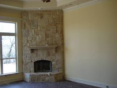 what not to do for corner fireplace. (notice awkward transition from bare wall to stone work) (see stucco / white wash options instead)