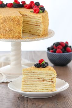 Napoleon Cake - Olga's Flavor Factory Napoleon Cake is a classic Russian cakes, made of very thin and flaky puff pastry cake layers and a smooth, rich and luscious pastry cream in between the layers. Russian Honey Cake, Russian Cakes, Russian Desserts, Russian Recipes, Napoleon Cake Russian, Napoleon Torte, Napoleon Dessert, Food Cakes, Cupcake Cakes