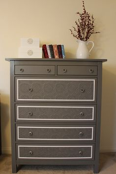 DIY dresser dress-up. Great tutorial that includes textured wallpaper, paint, and adding some white trimming.