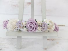 This flower crown features lavender/lilac roses mixing with white roses.  PLEASE NOTE Colours may appear lighter in the photos