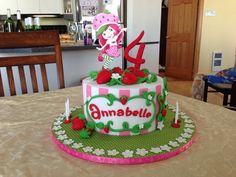 This Strawberry Shortcake birthday cake features fondant, gumpaste, food color gels, food color powder and ganache.  Inside is a  5-layer napolitean cake.