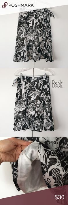 High waisted black & white floral midi skirt! ⚫️⚪️ Like brand-new, in excellent condition! You can wear it to a wedding, lunch, dinner, dancing, birthday party, shopping- YOU NAME IT! It's one of those pieces that will never go out of style and will serve you a great purpose. Measures approximately 23 inches long and 28 inches around the waist. Side zipper closure and tied up. It says euro size 38 which is US size 8 but it is not true to it, best fits size US two or four. 100% viscose. Miss…