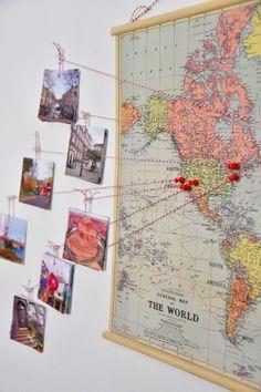 Decora tu cuarto con fotos de viajes y un mapa