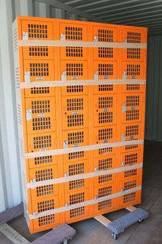 Vintage orange lockers - these would be awesome in a boys camo bedroom instead of a traditional dresser.