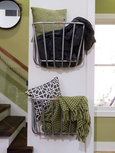 Repurposed hay-rack feeders designed for use in stable stalls are perfect in this context as simple wall-mounted storage baskets. (http://www.hgtv.com/on-tv/an-amazing-barn-conversion-from-hgtvs-elbow-room/pictures/index.html?soc=hgtvcom25992536)