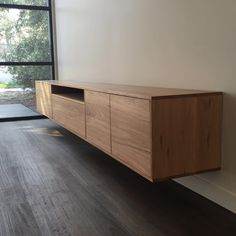 Loving how this Custom 3.5m blackbutt TV unit came out, strong contrast from the black stained floorboards to the pale tones of the unit. #recycledtimber #recycledtimberfurniture #interiordesign #surfcoast #torquay #messmate #interiordesignideas