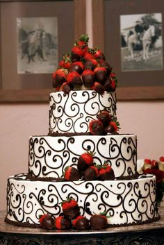 I love this cake but a 4 tier.... 1st (top) red velvet, 2nd white cake with strawberries, 3rd chocolate with strawberries, and 4th (bottom) red velvet !!