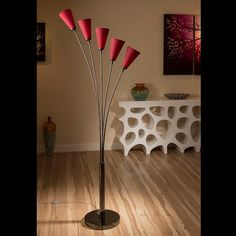 Stunning tulip standard floor light with red conical shades.  A truly stunning item with 5 beautiful dome glass shades and heavy nickel chrome base.  Made by Europe's top lighting manufacturer, please do not confuse with cheap Asian copies.  Deep red as depicted in the photos turns into bright glowing red when switched on.