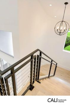 Adventure with Every Step. Modern Staircase with top beauty layer of premium European White Oak Green to the Core™ with sustainable foundation. Responsibly harvested from Lacey Act compliant forests. Backed by a 50-year residential warranty